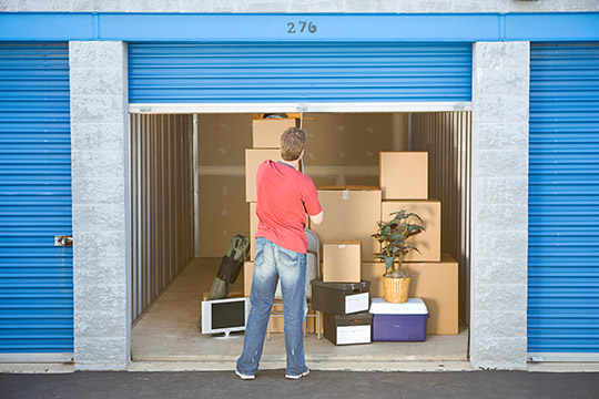 man looking at storage unit & Self Storage Units in Fairfield ME | Vehicle and Car Storage